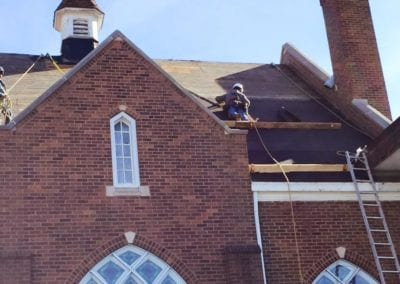 roofer working on putting new roof in church