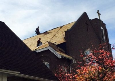 roofers working in church