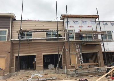 installing commercial siding by roofers