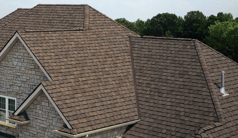 stone house with asphalt shingle roofing