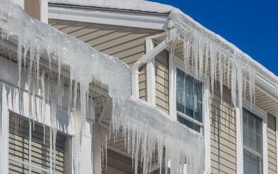 How do ice dams damage a roof?